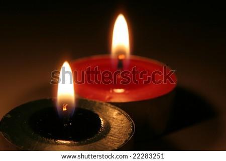 two lit christmas tea lights