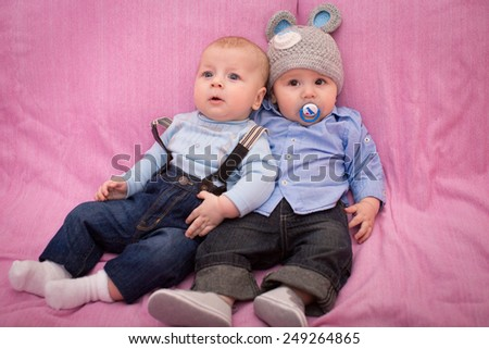 Two little baby boys - stock photo