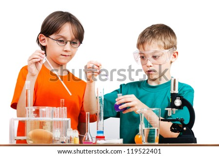 Two little boys doing biochemistry research at the lab. Isolated on white - stock photo