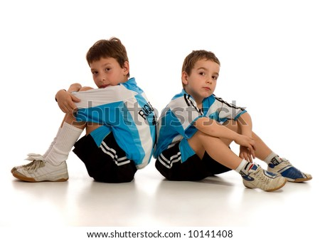 two little boys - football (soccer) players, isolated over white - stock photo