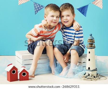Two little boys playing - stock photo