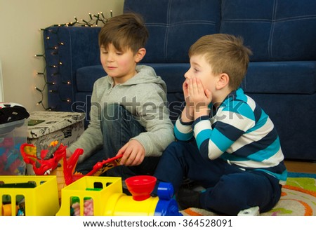 Two little boys playing at room - stock photo