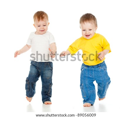 Two little boys playing game and running - stock photo