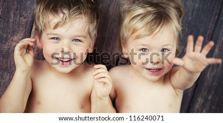 Two little boys smiling at the camera - stock photo
