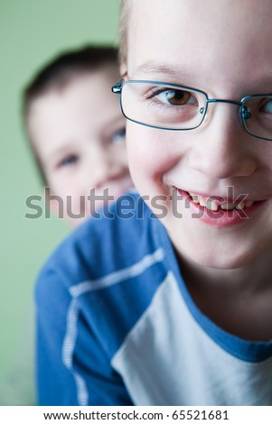 two little brothers happy together (shallow DOF; color toned image) - stock photo