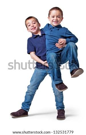 Two Little Brothers in the Studio on a Grey Background