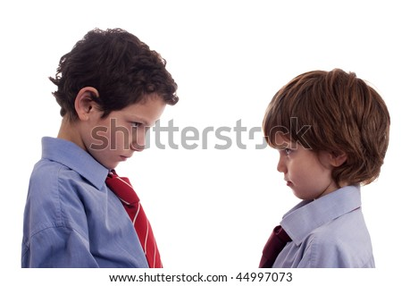 two little businessmen confronted, face to face - stock photo