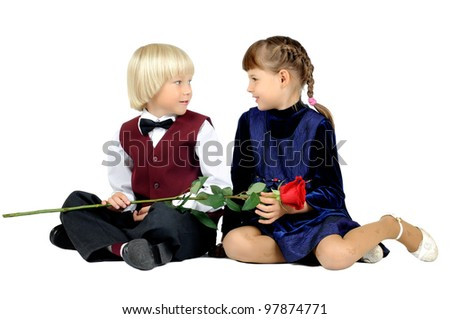 two  little children  embrace and smile, on white background, isolated
