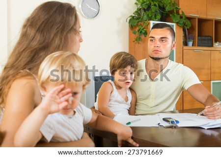 Two little children watching parents abusing one another at home  - stock photo