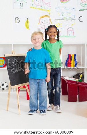 two little classmates in preschool classroom