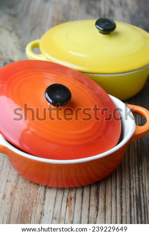 Two little colorful cooking pots for julienne - stock photo