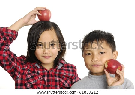 Two little couple kids with red apple - stock photo