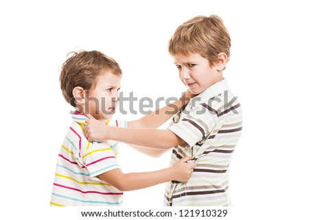 Two little displeased child boy brothers fighting in family conflict - stock photo