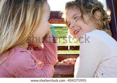 Two little female friends having fun outdoor. - stock photo
