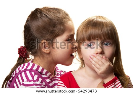 Two little girlfriends one telling a secret to another isolated over white background
