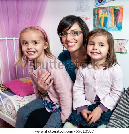 Two little girls and their mother - stock photo
