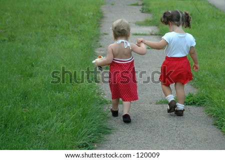 Two little girls are walking away