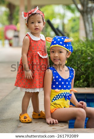 two little girls at pool - stock photo