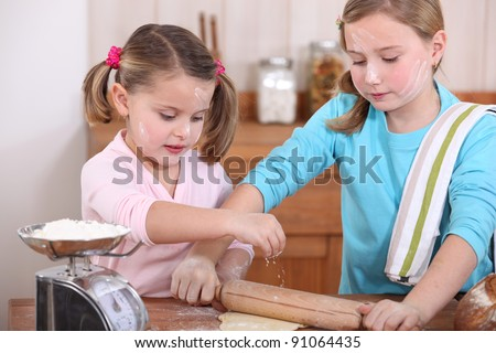 Two little girls baking
