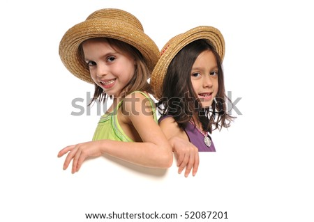 Two little girls holding a blank sign isolated on a white background - stock photo