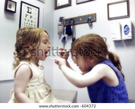Two little girls in a medical office playing doctor - stock photo