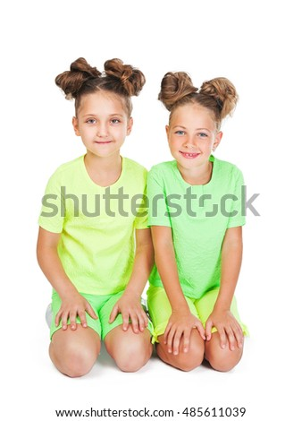 two little girls in similar fancy garb