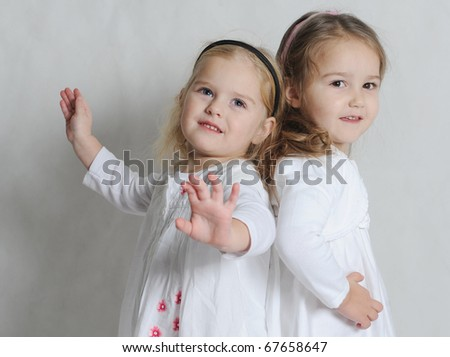 Two little girls in white - stock photo