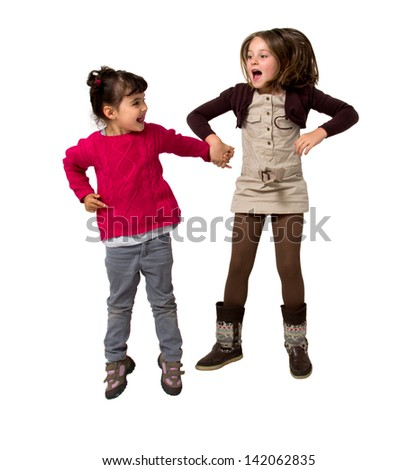 two little girls jumping isolated on white