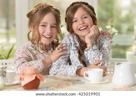 Two little girls laughing - stock photo