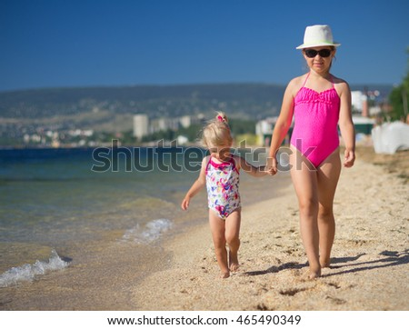 Two little girls on sea coast