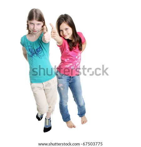 two little girls showing the thumbs in studio