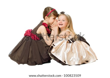 Two little girls talking. Isolated on white - stock photo