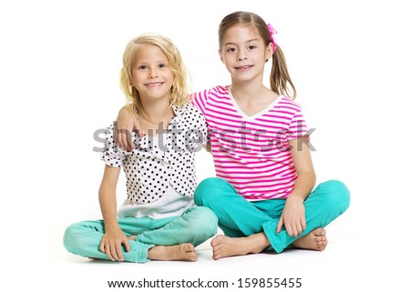 Two little girls who are best friends isolated on white - stock photo