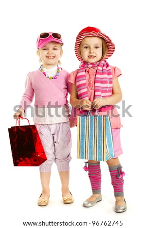 Two little girls - with shopping bags isolated over white - stock photo