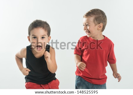 Two little kid with running gesture - stock photo