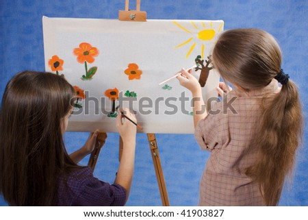 Two little painters drawing - stock photo