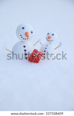 Two little self made snowmen  - stock photo