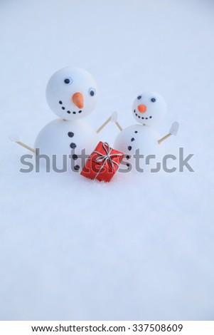 Two little self made snowmen  - stock photo