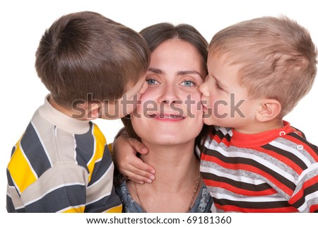 Two little sons are kissing their pretty mom; isolated on the white background - stock photo