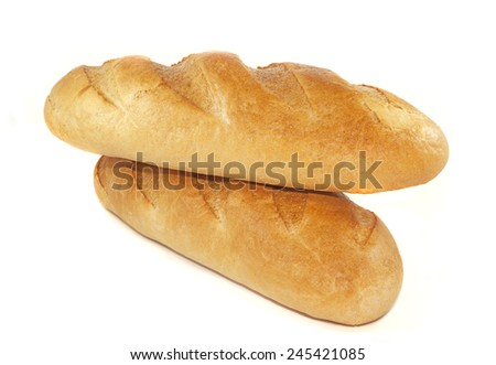 Two loaves of bread on a white background - stock photo