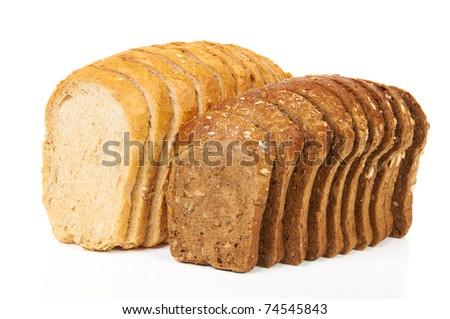 Two loaves of light and dark bread isolated on white - stock photo