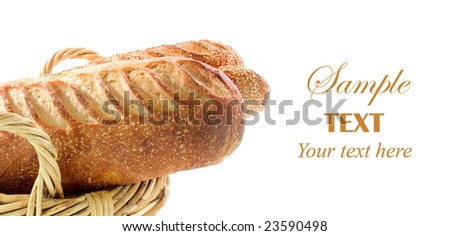 Two loaves of sour dough bread in wicker basket over white background with copy space for text.