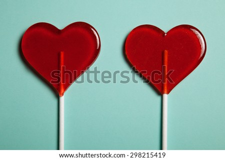Two lollipops. Red hearts. Candy. Love concept. Valentine day. - stock photo