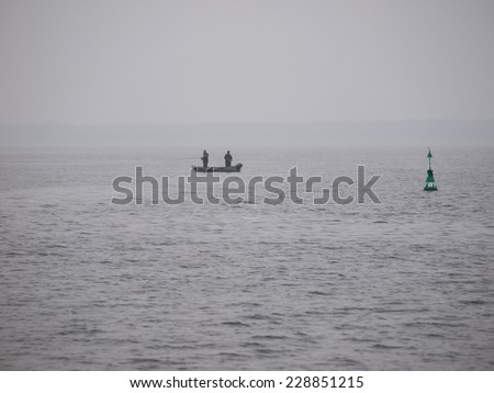 two lone fisherman on the sea