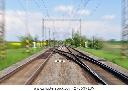 Two long railway tracks. Blurred with zoom - stock photo