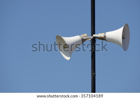 Two loudspeakers on a tall column - stock photo