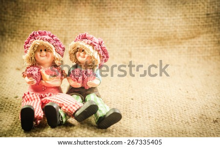 Two Lovely doll sitting  in a vintage retro style backgrounds for the day of love, - stock photo