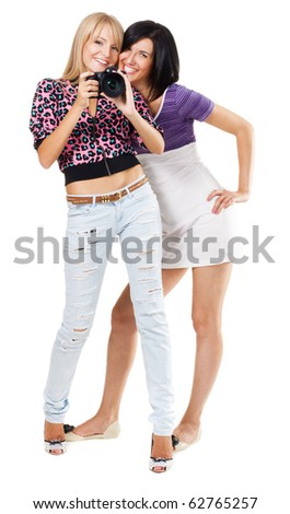 Two lovely friends with a camera, white background - stock photo