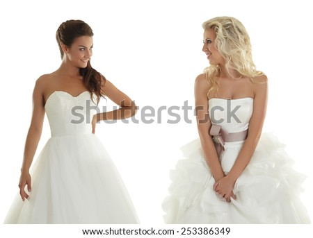 Two lovely girlfriends in wedding dresses - stock photo