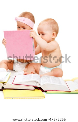 Two lovely kids holding a book and reading it, over white - stock photo
